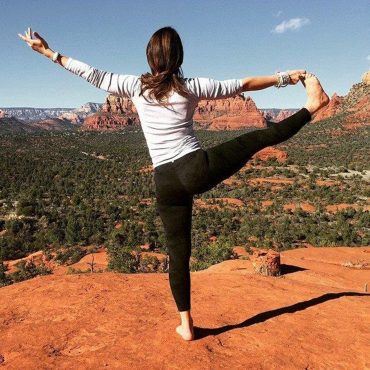 Natasha Moine in standing yoga pose in the Grand Canyon